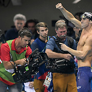 United States swimmer Michael Phelps reacted to his gold medal victory in the men's 200m butterfly final at the 2016 Summer Olympics Games in Rio de Janeiro, Brazil.