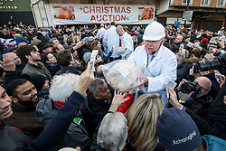 © Licensed to London News Pictures. 24/12/2018. London, UK. Butcher Harts of Smithfield auction off cuts of meat to the public on Christmas Eve at Smithfield Market in London. Photo credit: Rob Pinney/LNP