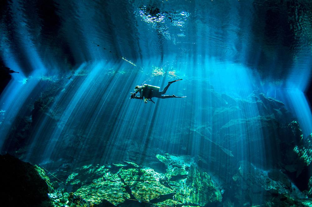 A diver explores Chac Mool Cenote in Quintana Roo, Mexico.