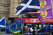 As Prime Minister Theresa May again meets opposition Labour leader Jreemy Corbyn in an attempt to break the deadlock in parliament of Brexit, a bus ad passes protestors opposite parliament in Westminster, on 4th April 2019, in London, England.