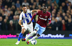 Brighton & Hove Albion's Beram Kayal (left) and West Ham United's Pedro Obiang battle for the ball during the Premier League match at the AMEX Stadium, Brighton.