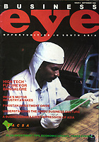 Business Eye magazine cover with Micropack worker checks a printed circuit board (PCB).<br /> Couverture du magazine Business Eye: Un ouvrier de Micropack vérifie un circuit imprimé, Bangalore, India.