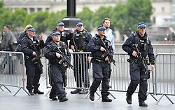 Armed police officers patrol the area ahead of a vigil in Potters Fields Park, central London, in honour of the London Bridge terror attack victims.