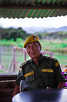 This Kelabit man, a retired headmaster, has had his long ears clipped, as many others have done in recent times, now helps out with secuirty at the local airport .