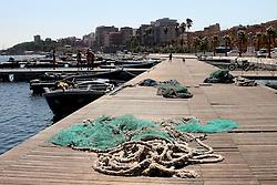 Porticciolo sul mar piccolo di Taranto, in lontananza il borgo nuovo della città.