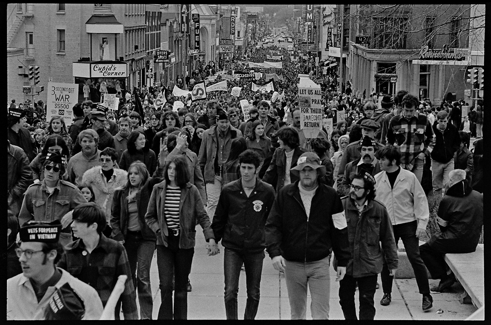 Madison, WI – May, 1970. Protesters against the war in Vietnam march up State Street towards the Capitol, led by Veterans for Peace in Vietnam. On May 1, 1970, there was a general student strike in response to the news that the U.S. had expanded bombing into Cambodia. There was a march against the war, led by Veterans for Peace in Vietnam; and after the May 4 shootings at Kent State University in Ohio, there were more protests at UW Madison, which led to the police being called in, and teargassing demonstrators in the streets and on campus.  Marchers on State Street.