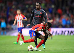 Arsenal's Danny Welbeck (left) and Athletico Madrid's Partey Thomas battle for the ball during the UEFA Europa League, Semi Final, Second Leg at Wanda Metropolitano, Madrid.