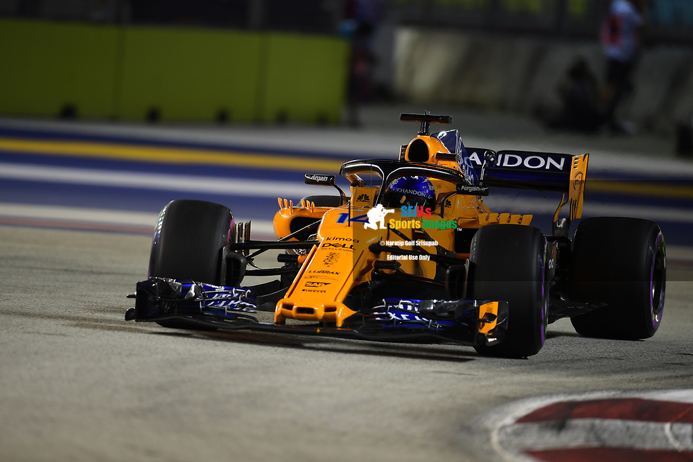 SINGAPORE - SEPTEMBER 16: Fernando Alonso (14) of McLaren Formula 1 Team in action during F1 Singapore Grand Prix 2018, Marina Bay Street Circuit, Singapore on September 16, 2018. <br /> .<br /> .<br /> .<br /> (Photo by: Naratip Golf Srisupab/SEALs Sports Images)<br /> .<br /> Any image use must include a mandatory credit line adjacent to the content which should read: Naratip Golf Srisupab/SEALs Sports Images