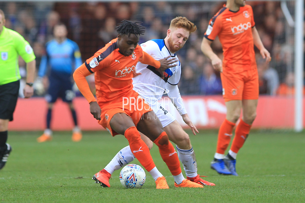 Callum Camps makes a challenge during the EFL Sky Bet League 1 match between Luton Town and Rochdale at Kenilworth Road, Luton, England on 2 March 2019.