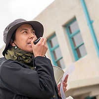 Rally leader and Somos Gallup organizer, Elsa Lopez, left, leads a chant during the May Day Workers' Rights March Tuesday in front of the Gallup Cultural Cener.