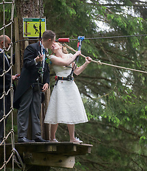 Martin Milner and Colette Gregory after tying the knot in the trees at Go Ape Aberfoyle, after the climbing net.