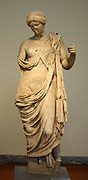 Statue of armed Aphrodite.  Parian marble, found in Epidaurus.  The sheath of the sword held in the goddess' raised right hand crosses her chest.  1st century AD copy of an original dated to circa 400 BC and carved by a sculptor of the school of Polykleitos, possibly Polykleitos the Younger.