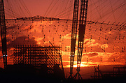 A 1998 construction landscape at sunrise of The Millennium Dome pylons (later to become the 02 Arena) on the Greenwich Peninsular, on 25th March 1998, in London, England.