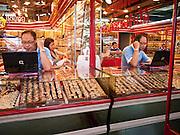 24 JUNE 2011 - CHIANG MAI, THAILAND: A gold merchant in the market in Chiang Mai, Thailand.  PHOTO BY JACK KURTZ