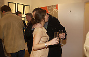 """Natasha Law and Johnny Lee Miller,  """"Hold""""  exhibition of work by Natasha Law at Eleven.  January 12 2006. London. ONE TIME USE ONLY - DO NOT ARCHIVE  © Copyright Photograph by Dafydd Jones 66 Stockwell Park Rd. London SW9 0DA Tel 020 7733 0108 www.dafjones.com"""