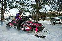 Daisy Medeiros gets an early season ride in with her family following the Christmas snowstorm that blanketed the region.  (Karen Bobotas/for the Laconia Daily Sun)