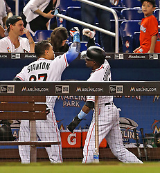 August 14, 2017 - Miami, FL, USA - Giancarlo Stanton is congratulated by Dee Gordon as he breaks the Marlins' season homerun record hitting his 43rd dinger of the season as the Miami Marlins host the San Francisco Giants on Monday, Aug. 14, 2017 in Miami. (Credit Image: © Patrick Farrell/TNS via ZUMA Wire)