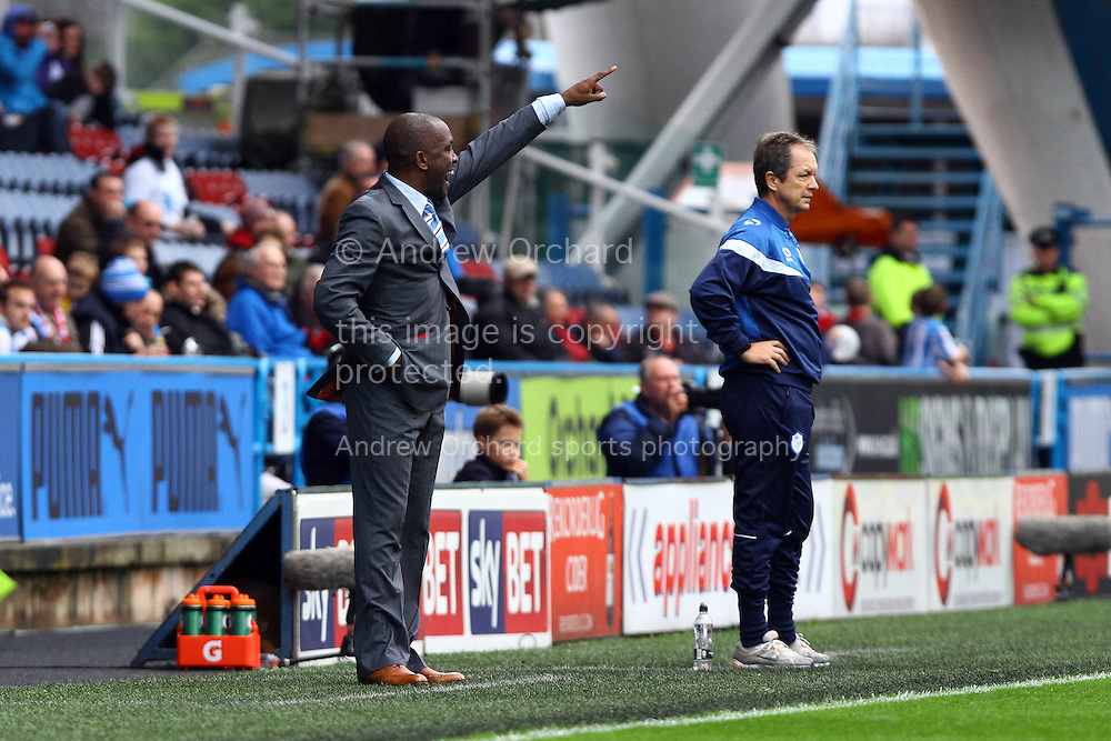 Hudersfield Manager Chris Powell makes his point while Sheffield Wednesday Head Coach Stuart Gray looks on. Skybet football league championship match, Huddersfield Town v Sheffield Wednesday at the John Smith's stadium in Huddersfield, Yorkshire on Saturday 22nd November 2014.<br /> pic by Chris Stading, Andrew Orchard sports photography.