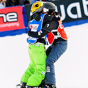 Snowboard-Cross racers Olivia Nobs (SUI) and Mellie Francon (SUI) congratulate each other after finishing in the first and second positions during their quarter-final race at the 2009 LG Snowboard FIS World Cup on February 13th, 2009 at Cypress Mountain, British Columbia. Mandatory Photo Credit: Bella Faccie Sports Media\Thomas Di Nardo. Contact: Thomas Di Nardo, Snohomish, Washington, USA. Telephone 425-260-8467. e-mail: tom@bellafaccie.com