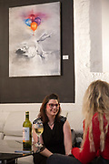 Two woman talking during the launch night of Irish artist, Mr. Everybodys solo art exhibition at the Underdog London gallery on the 8th March 2019 in South London in the United Kingdom.