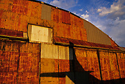 Image of an old abandoned airplane hangar with the shadow of a plane in Wendover, Utah, American Southwest by Randy Wells