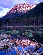 Hazelton Range reflected in Seeley Lake, Seeley Lake Provincial Park, British Columbia, Canada.