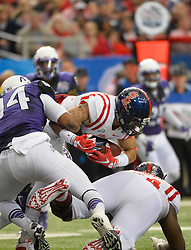 First half action in the Ole Miss vs. TCU Chick-fil-A Peach Bowl football game at the Georgia Dome on December 31, 2014. David Tulis / Abell Images for the Chick-fil-A Bowl