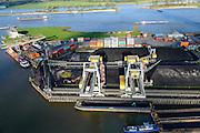 Nederland, Gelderland, Nijmegen, 24-10-2013. Noordkanaalhaven, gelegen aan de kruising van de Waal en het Maas-Waalkanaal. Containerterminal en overslag van kolen.<br /> <br /> Port in Nijmegen (central Netherlands), container terminal and transshipment of coal . The river Waal.<br /> <br /> luchtfoto (toeslag op standaard tarieven);<br /> aerial photo (additional fee required);<br /> copyright foto/photo Siebe Swart.