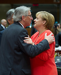 Jean-Claude Juncker, Luxembourg's prime minister, left, greets Angela Merkel, Germany's chancellor, during the European Summit meeting at EU Council headquarters in Brussels, Belgium, on Thursday, June 17, 2010. (Photo © Jock Fistick)