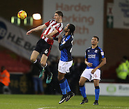 Chris Basham of Sheffield Utd gets above Nathan Delfouneso of Swindon Town during the English League One match at Bramall Lane Stadium, Sheffield. Picture date: December 10th, 2016. Pic Simon Bellis/Sportimage