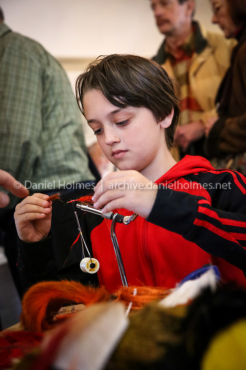 (3/20/16, SUDBURY, MA) Ethan Holmes ties a fly during the ninth annual fly-tying exhibition at The Wayside Inn in Sudbury on Sunday. Daily News and Wicked Local Photo/Dan Holmes