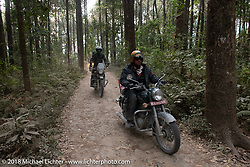 Rip Rolfsen riding out through the forest from the Kusma Gyadi Bridge on Day-7 of our Himalayan Heroes adventure riding from Tatopani to Pokhara, Nepal. Monday, November 12, 2018. Photography ©2018 Michael Lichter.