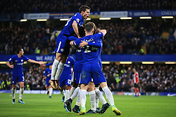16 December 2017 -  Premier League - Chelsea v Southampton - Team mates mob Marcos Alonso of Chelsea after he scores the opening goal - Photo: Marc Atkins/Offside