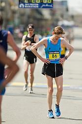 2013 Boston Marathon: Patrick Kuhlmann, 42, DC, staggers after crossing finish line