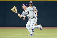 TCU's Austen Wade (8) cacthes a pop out against Texas A&M during the 3rd inning of a NCAA college baseball super regional tournament game, Friday, June 10, 2016, in College Station, Texas. (AP Photo/Sam Craft)