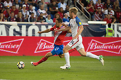 """September 1, 2017 - Harrison, New Jersey, U.S - Costa Rica forward MARCO URE""""A (21) takes a shot on goal while defended by USMNT defender TIM REAM (14) during a World Cup qualifier match at Red Bull arena in Harrison, NJ.  Costa Rica defeats USA 2 to 0. (Credit Image: © Mark Smith via ZUMA Wire)"""