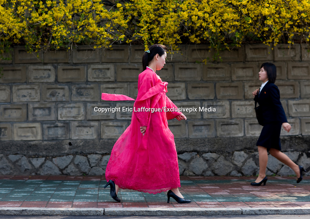 "Fashion in North Korea<br /> <br /> In every corner of the earth, women love to look beautiful and keep up with the latest fashion trends. The women of North Korea are no different. Fashion is taken seriously here. But in North Korea, women do not read Elle or Vogue; they just glimpse a few styles by watching TV or by observing the few foreigners who come to visit. In the hermit kingdom, clothing also reflects social status. If you have foreign clothes it means you travel and are consequently close to the centralized power. Chinese products have inundated the country, adding some color to the traditional outfits that were made of vynalon fiber. But citizens beware, too much style means you're forgetting the North Korean juche, the ethos of self-reliance that the country is founded on! But the youth tend to neglect it despite the potential consequences.<br /> <br /> Photo shows:Many women still wear this colorful, traditional kimono-like dress known as the ""choson-ot"" on a daily basis. It is called ""hanbok""in South Korea.<br /> ©Eric Lafforgue/Exclusivepix Media"