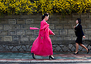 """Fashion in North Korea<br /> <br /> In every corner of the earth, women love to look beautiful and keep up with the latest fashion trends. The women of North Korea are no different. Fashion is taken seriously here. But in North Korea, women do not read Elle or Vogue; they just glimpse a few styles by watching TV or by observing the few foreigners who come to visit. In the hermit kingdom, clothing also reflects social status. If you have foreign clothes it means you travel and are consequently close to the centralized power. Chinese products have inundated the country, adding some color to the traditional outfits that were made of vynalon fiber. But citizens beware, too much style means you're forgetting the North Korean juche, the ethos of self-reliance that the country is founded on! But the youth tend to neglect it despite the potential consequences.<br /> <br /> Photo shows:Many women still wear this colorful, traditional kimono-like dress known as the """"choson-ot"""" on a daily basis. It is called """"hanbok""""in South Korea.<br /> ©Eric Lafforgue/Exclusivepix Media"""