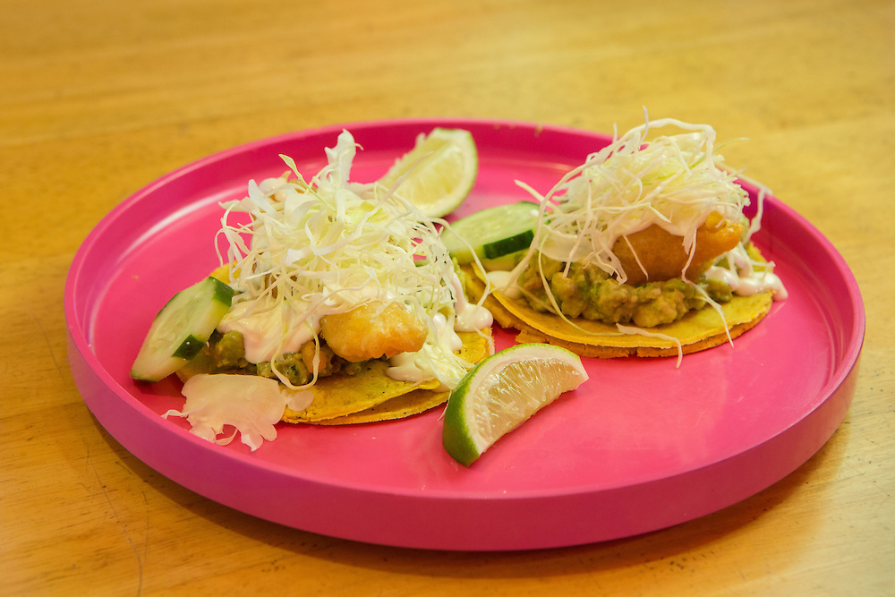 New York, NY - 11 February 2014. Fish tacos with skate wing tempura, avocado and crema at Mission Cantina, Danny Bowien's latest restaurant in New York's Lower East Side.