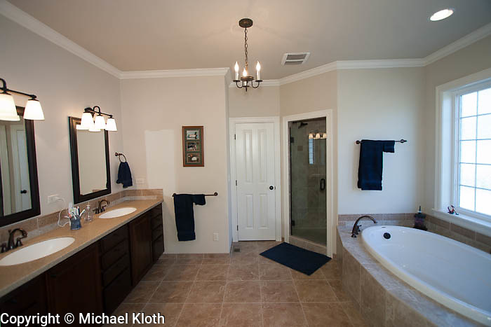 Master bathroom.  Walk in shower with two heads, Jacuzzi brand tub.  Windows are textured for complete privacy.