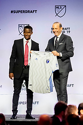 January 11, 2019 - Chicago, IL, U.S. - CHICAGO, IL - JANUARY 11: Siad Haji poses for a photo with MLS commissioner Don Garber after being selected as the number two overall pick to the San Jose Earthquakes in the first round of the MLS SuperDraft on January 11, 2019, at McCormick Place in Chicago, IL. (Photo by Patrick Gorski/Icon Sportswire) (Credit Image: © Patrick Gorski/Icon SMI via ZUMA Press)