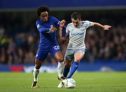 """Chelsea's Willian (left) and Everton's Leighton Baines (right) battle for the ball during the Carabao Cup, Fourth Round match at Stamford Bridge, London. PRESS ASSOCIATION Photo. Picture date: Wednesday October 25, 2017. See PA story SOCCER Chelsea. Photo credit should read: Nigel French/PA Wire. RESTRICTIONS: EDITORIAL USE ONLY No use with unauthorised audio, video, data, fixture lists, club/league logos or """"live"""" services. Online in-match use limited to 75 images, no video emulation. No use in betting, games or single club/league/player publications."""