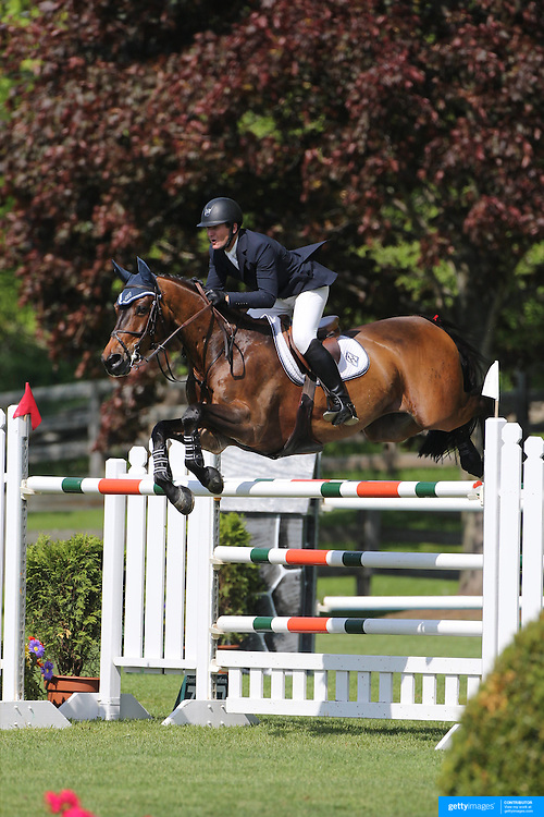 McLain Ward riding HH Carlos Z in action during the $100,000 Empire State Grand Prix presented by the Kincade Group during the Old Salem Farm Spring Horse Show, North Salem, New York,  USA. 17th May 2015. Photo Tim Clayton