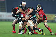 Stuart McInally  of Edinburgh Rugby © is stopped by Sam Davies and Josh Matavesi of the Ospreys (l). Guinness Pro12 rugby match, Ospreys v Edinburgh Rugby at the Liberty Stadium in Swansea, South Wales on Friday 2nd December 2016.<br /> pic by Andrew Orchard, Andrew Orchard sports photography.