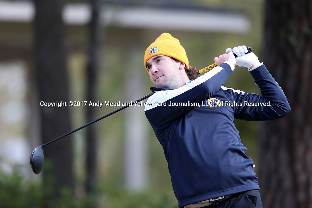 WILMINGTON, NC - MARCH 19: Kent State's Josh Whalen (CAN) tees off on the Ocean Course seventh hole. The first round of the 2017 Seahawk Intercollegiate Men's Golf Tournament was held on March 19, 2017, at the Country Club of Landover Nicklaus Course in Wilmington, NC.