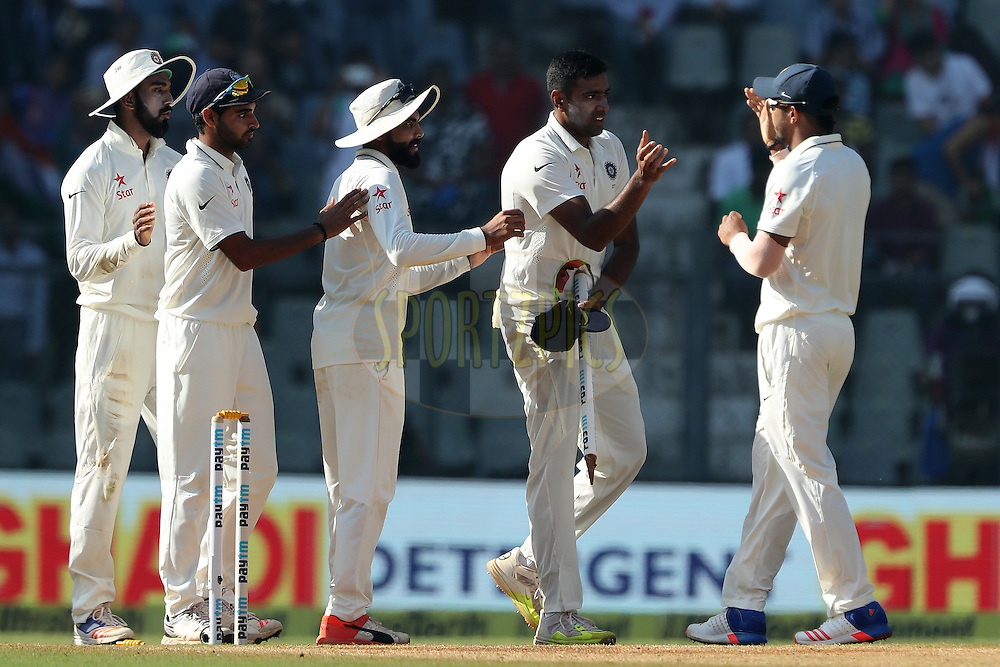 Ravichandran Ashwin of India celebrates the win during day 5 of the fourth test match between India and England held at the Wankhede Stadium, Mumbai on the 12th December 2016.<br /> <br /> Photo by: Ron Gaunt/ BCCI/ SPORTZPICS