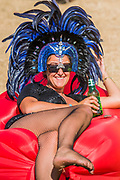 It is so hot today that all the shade trees can provide is used and there is a wide range of headgear for those in the sun - The 2018 Latitude Festival, Henham Park. Suffolk 15 July 2018