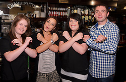 © Licensed to London News Pictures. 05/10/2011 London, UK. X Factor finalist Sophie Habibis with fellow bar staff at The Whittington Stone pub in Archway, London where she worked before entering the competition. Sophie, 19 was revealed as one of judge Kelly Rowland's final four contestants who will compete in the live finals. Photo credit : Simon Jacobs/LNP