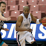 Efes Pilsen's Charles SMITH (R) and Besiktas's Brad NEWLEY (L) during their Turkish Basketball league Play Off semi final first match Efes Pilsen between Besiktas at the Ayhan Sahenk Arena in Istanbul Turkey on Sunday 09 May 2010. Photo by Aykut AKICI/TURKPIX