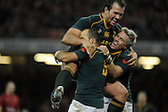 South Africa's Fourie Du Preez (l) celebrates with teammate Jean De Villiers (r) after he scores his try in 2nd half.  Autumn International rugby, 2013 Dove men series, Wales v South Africa at the Millennium Stadium in Cardiff,  South Wales on Saturday 9th November 2013. pic by Andrew Orchard, Andrew Orchard sports photography,